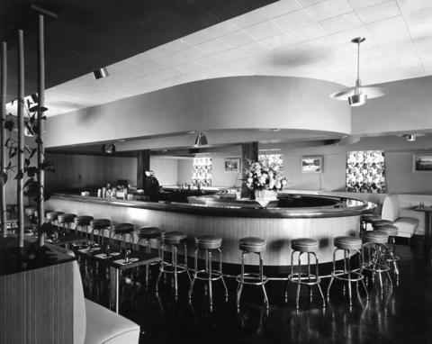 "July, 1954: Shot of the ""White Derby,"" which is the new Enlisted Men's Club at the air station. The remodel took about four months and cost approximately $23,000. New additions included a horseshoe-shaped bar, a draught beer dispenser and white leather booths. The club was located downstairs in the Recreation Building."