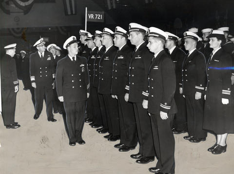 Sept., 1952: Rear Adm. John Dale Price (center) inspects part of the 2,000 naval air reservists during ceremonies at the base.