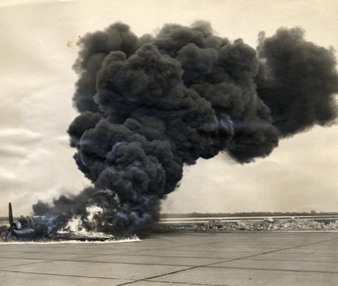 "Feb., 1947: Smoke and flames engulf a plane at an ""operations reunion"" exhibition, which 15,000 attended."