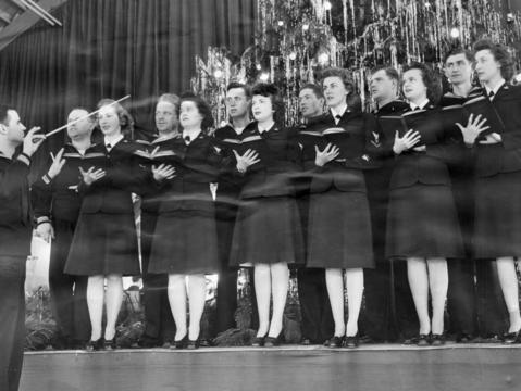 Dec., 1943: The Glenview Air Base choral group sings Christmas carols.