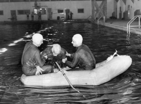 March, 1943: Emil Erricson, Richard Torrey and Richard Gluss demonstrate a rubber life raft rescue in the Glenview swimming pool.