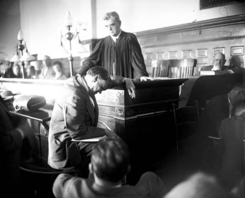 Chief defense attorney and noted Chicago lawyer, Clarence Darrow, seated, makes his case before Judge John R. Caverly in the murder case against Richard Loeb and Nathan Leopold Jr., in the summer of 1924. Darrow's masterful handling of the case has been the subject of books and movies.