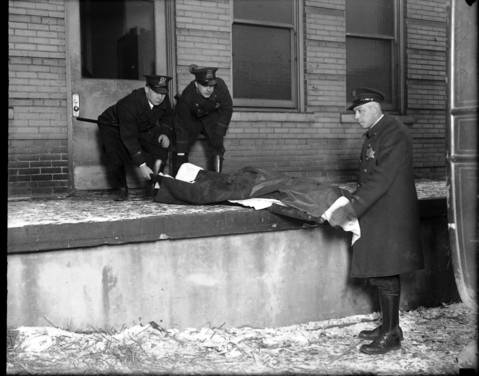"""The body of Albert Kachellek, aka """"James Clark"""", is removed from the county morgue on Feb. 15, 1929. Clark was the brother-in-law of gang leader George """"Bugs"""" Moran and was said to have the reputation of a hardened killer."""
