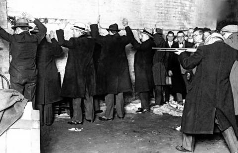 The coroner jurors watch a re-enactment of the St. Valentine's Day massacre of 1929.