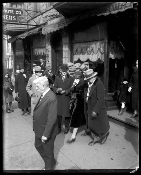 Mrs. Josephine Schwimmer (with handkerchief), the mother of Dr. Reinhardt Schwimmer, leaves the chapel at the funeral for her son on Feb. 18, 1929. Schwimmer, an optometrist with a hoodlum complex, was one of the seven men killed during the St. Valentine's Day Massacre on Feb. 14, 1929.