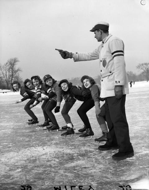 Peter Miller holds the starter gun for Mary Allen (CYO), from left, Marian Laise (CYO), Luetta DuMez (CYO), Nadine Hanson (Peirce), Betty Verhulst (Swift) and Rosalie Weiss (Peirce) at Garfield Park in1943.