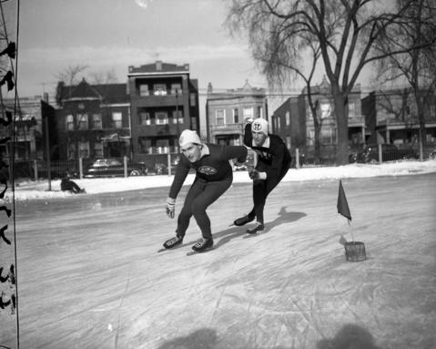 Buddy Solem of the Catholic Youth Organization, left, and Ken Henry, of N.W., ice skate in 1950.