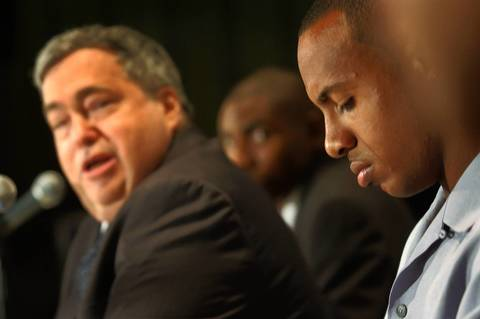 Jerry Krause looks over at his No. 1 Bulls pick Jay Williams as he addresses reporters during a press conference on June 27, 2002.