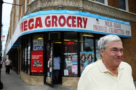 Jerry Krause outside a shop once owned by his parents during his childhood in the Albany Park neighborhood in 2012.