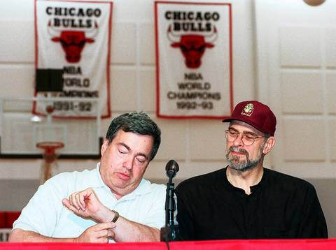 Bulls GM Jerry Krause looks at his watch during a press conference with coach Phil Jackson at the Berto Center on May 15, 1997. They announced that Jackson had re-signed with the team for a 1-year contract.