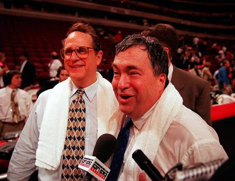 Jerry Krause and Jerry Reinsdorf celebrate a Bulls win over the Jazz in the NBA finals in 1997.