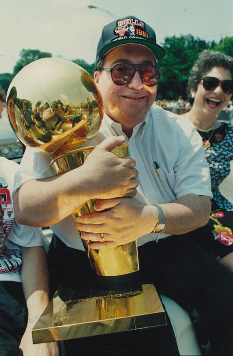 Jerry Krause, is one happy general manager as he embraces the Bulls' championship trophy during the rally at Grant Park.