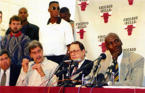 Michael Jordan (right) announces his retirement at the Berto Center in Deerfield on October 6, 1993. Seated from left: Bulls GM Jerry Krause, Bulls coach Phil Jackson, Bulls owner Jerry Reinsdorf and Jordan. Bulls forward Scottie Pippen is in the rear, wearing sunglasses.