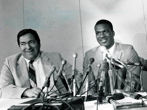 Jerry Krause share a laugh with Charles Oakley at a press conference, where the No. 1 draft choice signed a three-year contract on Sept. 26, 1985.