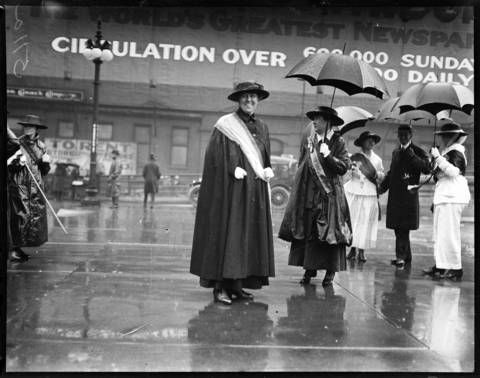 Janet Ayer Fairbank, of Chicago, center, was a prominent suffragette who had the honor of being the grand marshall for the suffrage parade held on a rainy June 7, 1916. More than 5,000 suffragettes marched in Chicago to the Republican National Convention in a heavy rainstorm to push for woman to have the right to vote. Undated photo.