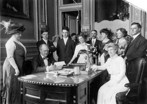 On June 26, 1913, Governor Edward F. Dunne, seated, of Illinois signed the Suffrage Bill that gave Illinois women the right to vote. Governor Dunne signed the bill in the presence of his wife, left, and suffragette leaders Grace Wilbur Trout, Elizabeth Booth, female lawyer Antoinette Funk and teachers union leader Margaret Haley, seated.