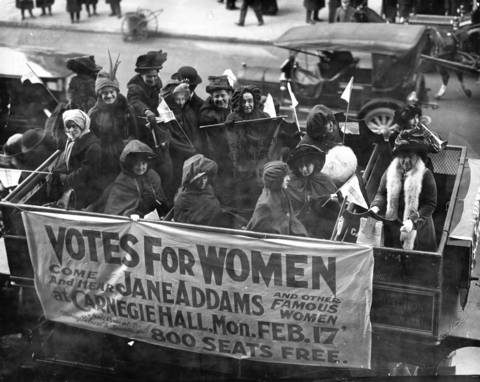 On Feb. 9, 1913, A banner advertises a talk on the women's suffrage movement by Jane Addams and others at Carnegie Hall in New York.