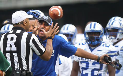 Hampton University coach Connell Maynor argues a call during the third quarter against Norfolk state Saturday September 26, 2015 in Norfolk.