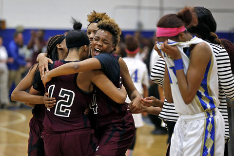 Heritage players celebrate after defeating Smithfield 49-48 in overtime during Thursday's Ironclad Conference 18 semifinal on February 18, 2016.