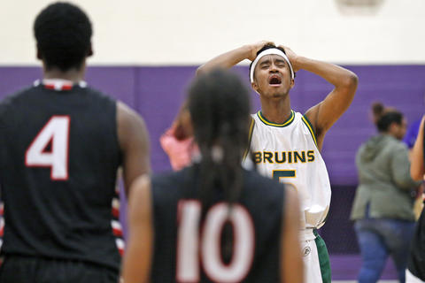 Bethel's Cam Bacote reacts after losing 45-42 to Hampton during Saturday's PenSouth Conference10 final at Menchville High School on February 20, 2016.