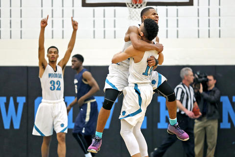 Woodside's Devante Carter, center, jumps into the arms of Jordan Forbes in celebration after defeating C.D. Hylton 54-51 during Thursday's 6A South regional semifinal on February 25, 2016.