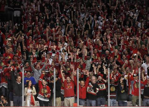 Chicago Blackhawks fans celebrate a goal in the third period in Game 5 of the Stanley Cup Final on June 22, 2013, at the United Center in Chicago.