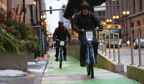 Divvy bicyclists ride in bike lanes during the morning rush hour on Jan. 22, 2016.