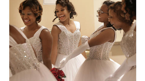 While waiting for the Red and White Debutante Cotillion to begin, the young women enjoy each other's company.