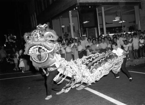 A lion dance is staged in the heart of Chinatown during a hin-wai, or festival, at 22nd Place and Wentworth Avenue in Chinatown in 1963.