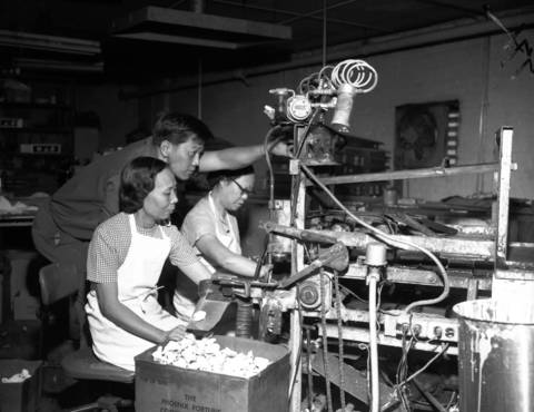 Yau Tak Cheung, an engineer, watches fortune cookies being made on the machine he invented at 123 S. Laflin St. in Chicago in 1966. Cheung, who created the Pheonix Fortune Cookie Co., came to the U.S. from Canada in 1957. He emigrated from Hong Kong in the early 1950s.