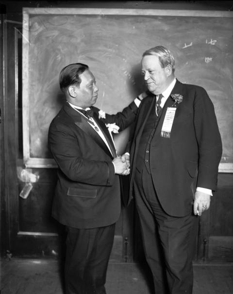 The 'mayor' of Chicago's Chinatown, William P. Lee, left, greets Illinois' Lt. Gov. Fred E. Sterling at a Chinese banquet in 1927.