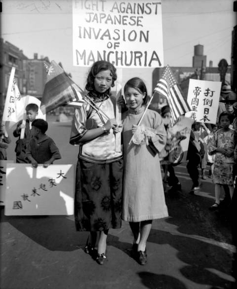 Jean and Gertrude Moy pose for a photo during a parade that 3,000 Chinese-Americans attended in Chicago to protest Japan's invasion of Manchuria in 1931.