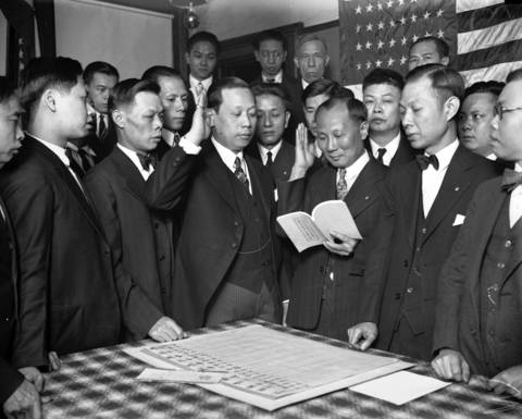 Secretary Charles Lau, from left, President Willie Lee, special director Jin Kit, and Vice President Wong Lock, pledge with other members of the Chinese-American Alliance located at 2223 Wentworth Ave. in Chinatown in 1928.