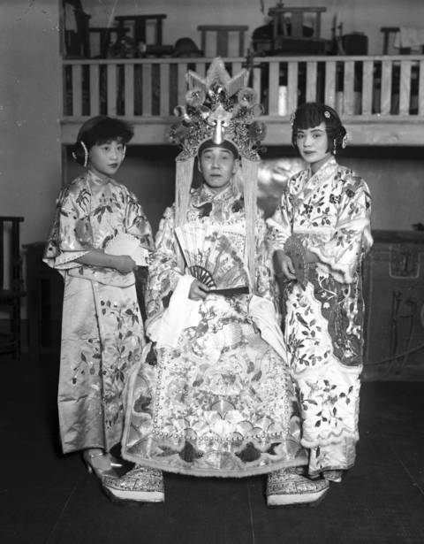 Two Chinese women and a man dress up to celebrate the 17th anniversary of the founding of the Republic of China in 1928 in Chinatown.