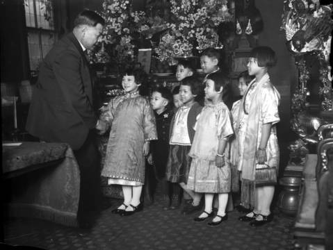 "Frank Moy, the ""mayor of Chinatown,"" celebrates the Chinese New Year with children in Chinatown in 1934."