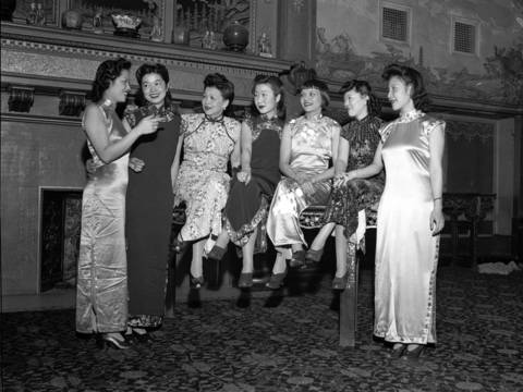 Mrs. Robert T. Huang, from left, Dorothy Leong, Mrs. George Moy, Miss Mei Yut Kuo, Helen Wong Jean, Marjorie Moy and Mrs. Arthur D.F. Toy, at the Nankin Restaurant located at 69 W. Randolph Street in 1942. The women modeled Chinese costumes for an upcoming Freedom Fair.