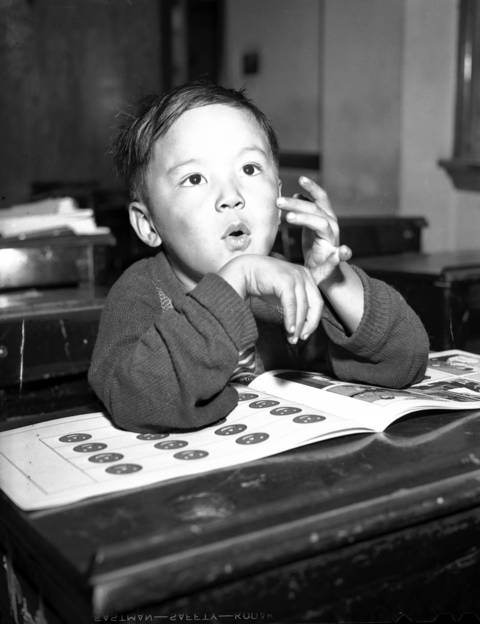Jimmy Jenkin Jr., 5, counts up to five in class at St. Therese Chinese Catholic School in 1941 in Chinatown.