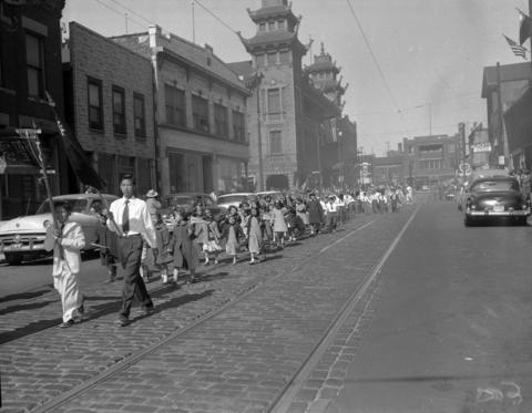 Chinese people parade on Wentworth Avenue in Chinatown to commemorate the 45th anniversary of the founding of the Republic of China in 1956.