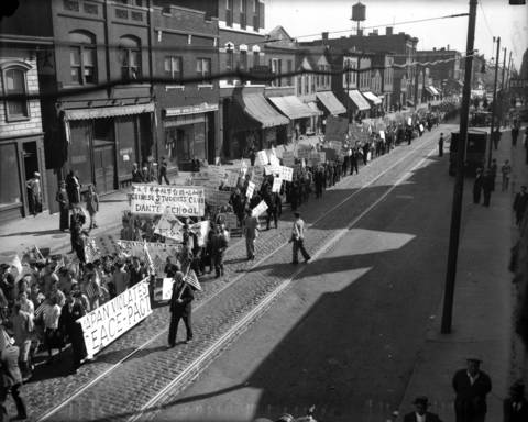 Chicago's Chinese-Americans protest the Japanese invasion of Manchuria on South Wentworth Avenue near 22nd Street in Chicago in 1931. All Chinatown shops were closed at noon for the protest.