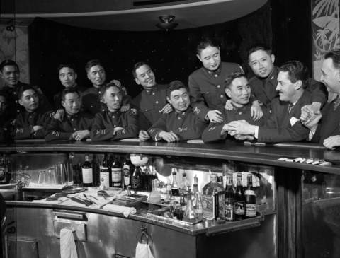 James Sterling and Samuel Worman, far right, held a party for 13 Chinese pilots who were studying at Scott Field in Illinois on April 7, 1944. Both Sterling and Worman said they would contribute $50 to the Chinese war relief for each plane shot down by the pilots.