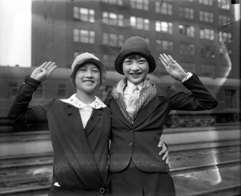 "Anna May Wong, right, Chinese-American movie star, and Lulu Wong on March 25, 1928. The Tribune reported, ""Oriental beauties stepped from the Golden State Limited yesterday morning into the bustle of the LaSalle Street Station. They were Lulu and Anna May Wong. Their stop in Chicago was for only a brief few hours between trains."" Anna May was on her way to Berlin to star in a movie."