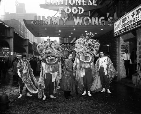 Chinese lions dance outside Jimmy Wong's restaurant in celebration of the Chinese New Year in 1965.