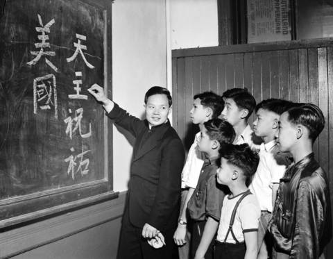 "The Rev. John Mao teaches ""God bless and protect America"" in Chinese to Edward Lee, 17, Richard Leong, 15, David Lee, 13, Robert Lam, 12, Robert Lee, 10, and Woodrow Lee in 1942."
