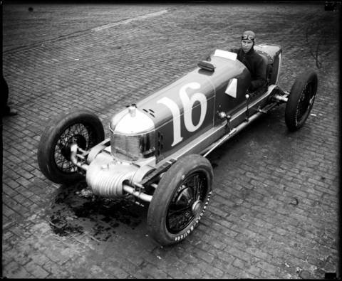 Ralph Hepburn in car #16, showing a front wheel drive Miller Special, circa May 29, 1928. Hepburn had been a pioneering motorcycle racing champion who went on to race fifteen times in the Indianapolis 500. In 1928 he finished 24th. According to the Tribune, in 1935 Hepburn drove with a short-wave radio in his car to communicate with the pit crew. Hepburn's best race was in 1937 when he finished 2nd, just 2.16 seconds behind the winner.