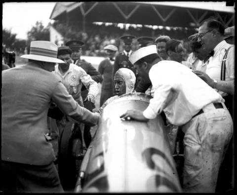 George Souders, in a Duesenberg, is surrounded after winning the Indianapolis 500 on May 30, 1927. Souders was a rookie that led the last 51 laps of the race with an average speed of 97.54 miles an hour.
