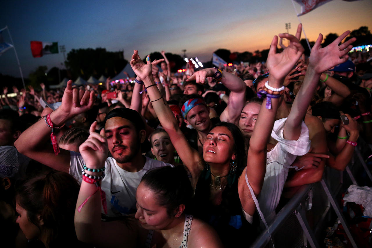 People groove to the music of Kaskade at the Spring Awakening festival in Addams Park on Chicago's West side on Saturday, June 11, 2016.