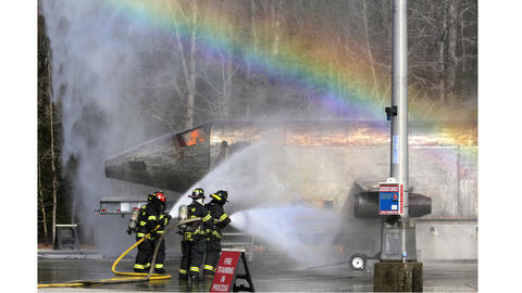 As the fire fighters worked to put out the propane ignited flames, a rainbow appeared from water sprayed from an assisting ladder truck. Using a parking lot at Thomas Nelson Community College, Langley Air Force Base conducted an exercise with Hampton Police and Fire Departments, on how to handle an airplane crash.