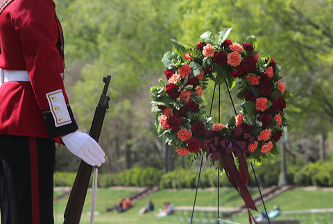 The College of William and Mary's color guard, known at the Queens' Guard, has laid a memorial wreath today at the entrance to the Sunken Garden in remembrance of the school shootings at Virginia Tech.
