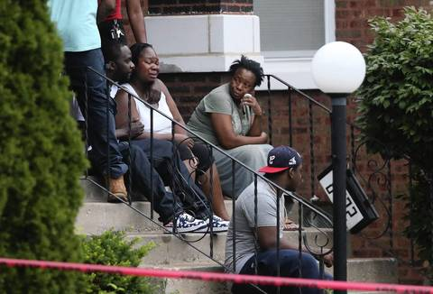 Georgina Utendhal is held by her fiance Andre Holden as they wait for details of her son who allegedly was shot and killed by a member of the Chicago Police Department in the alley of the 8700 block of South Morgan Street on July 5, 2014. On the right is Georgina's mother, Georgia Utendhal.