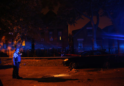 Police investigate the shooting scene at 28th Street and Homan Avenue in Little Village on July 5, 2014.